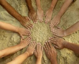 circle-of-hands-in-the-sand