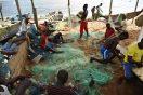 men-working-on-fishing-net
