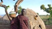 village-man-in-front-of-hut